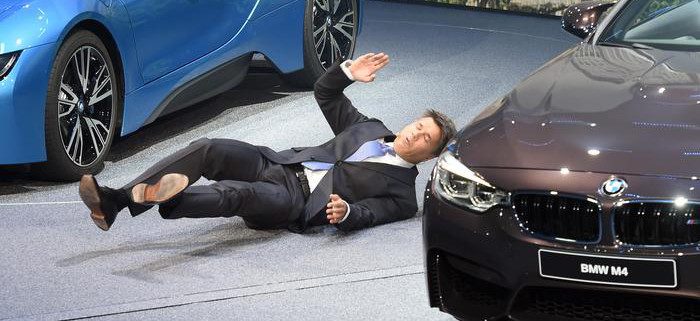 BMW CEO Harald Krueger faints during the BMW presentation on the first press day of the Frankfurt Auto Show in Frankfurt, Germany, Tuesday, Sept. 15, 2015.  (Uli Deck/dpa via AP)