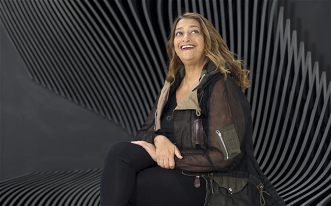 Bri0041097. Telegraph. Architect and designer Zaha Hadid poses in front of pieces of her own work in East London Friday July 06, 2012. Picture by Christopher Pledger