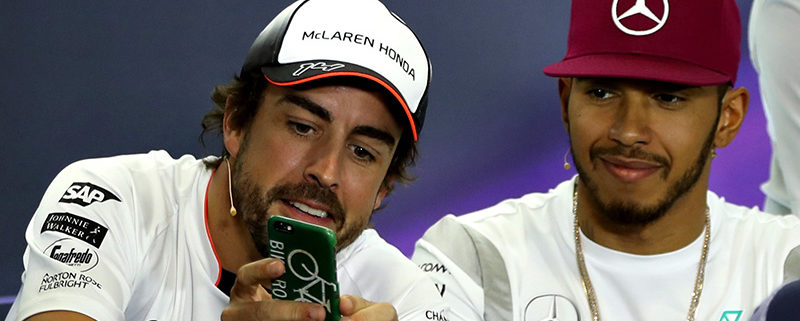 MONTMELO, SPAIN - MAY 12: Fernando Alonso of Spain and McLaren Honda shows Lewis Hamilton of Great Britain and Mercedes GP his phone in the Drivers Press Conference during previews to the Spanish Formula One Grand Prix at Circuit de Catalunya on May 12, 2016 in Montmelo, Spain.  (Photo by Mark Thompson/Getty Images)