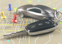 Car key on the map with local points of travel.