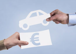 Hands taking paper icons of money and car. Leasing concept.