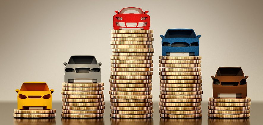Colored car silhouettes standing on gold coin stacks. 3D illustration.