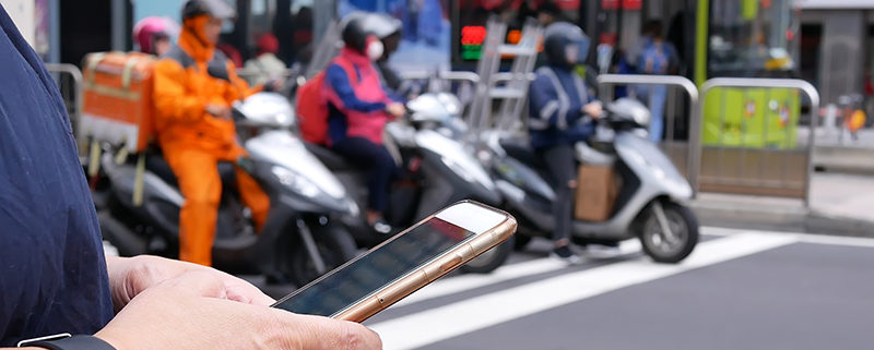 Motion of woman crossing street and using mobile phone in Taipei Taiwan